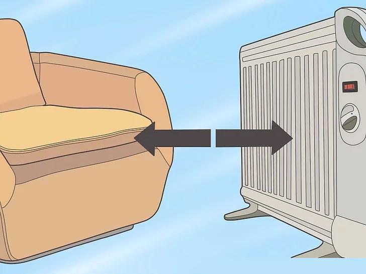 Đặt máy sưởi không gian tối thiểu 1m từ đồ nội thất, màn cửa hoặc quần áo