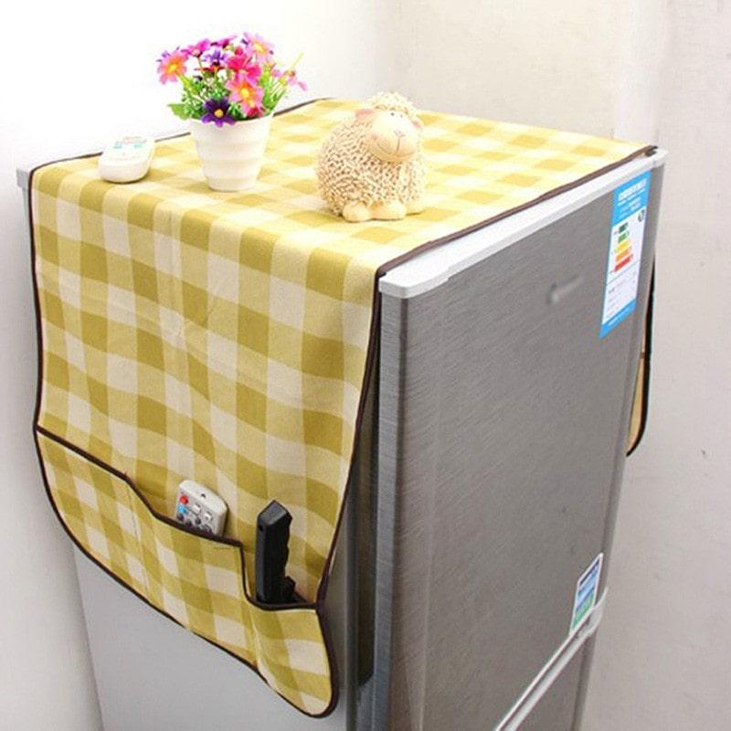 Đặt tấm vải màn lên nóc tủ lạnh